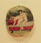 Couple fornicated on a red sofa